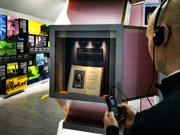 A visitor enjoys a self-guided audio tour of the Fabric of Athlone exhibition at Athlone Castle Visitor Centre.