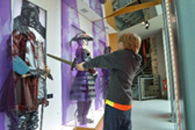 A young boy and his sword comes face to face with one of our tall Generals in command in the People of the Siege exhibition at Athlone Castle Visitor Centre.