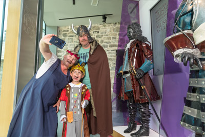 A family takes selfies with historical figures at Athlone Castle Visitor Centre